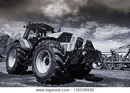 giant tractor and plows, slight selenium toning