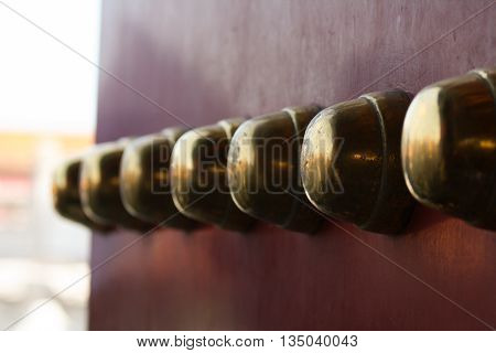 Ornamental knobs on the primary entrance door to the Forbidden City in Beijing
