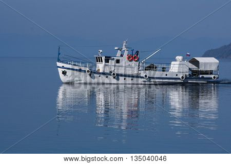 White boat on Lake Baikal in early morning. Russia