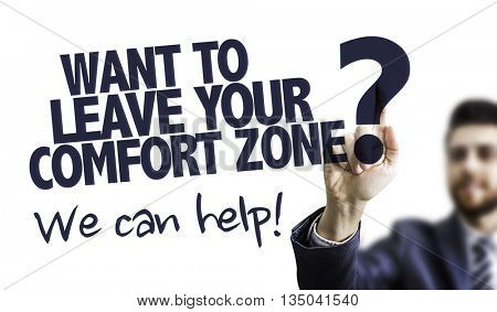 Business Man Pointing the Text: Want to Leave Your Comfort Zone? We Can Help!