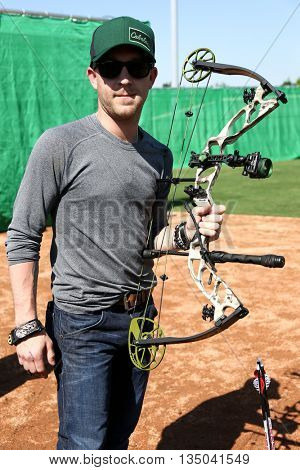 ARLINGTON, TX - APR 18: Recording artist Justin Moore poses at the ACM & Cabela's Great Outdoor Archery Event at the Texas Rangers Youth Ballpark on April 18, 2015.