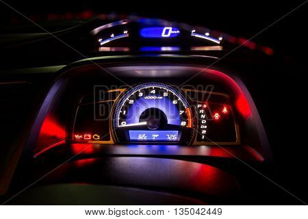 Modern car instrument dashboard panel and digital speed meter full symbol in night time