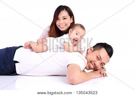 Asian parent playing with their six months old baby boy