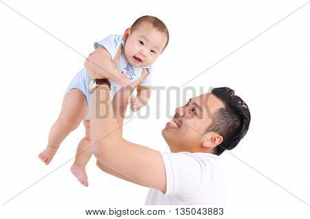 Asian father picking up his six months old baby boy