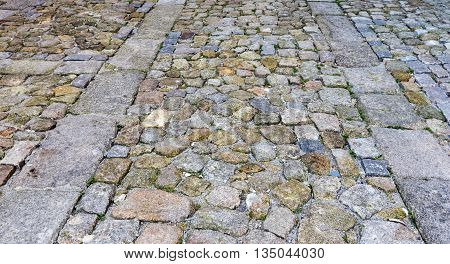Cobbled road in town as abstract background.