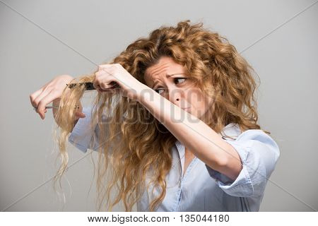 Woman cutting her own hair