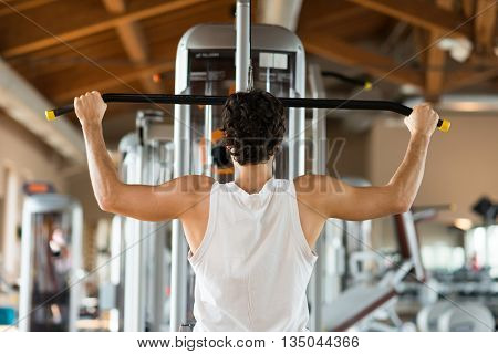 Young man training hard in a gym