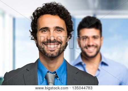 Two businessman sharing an office