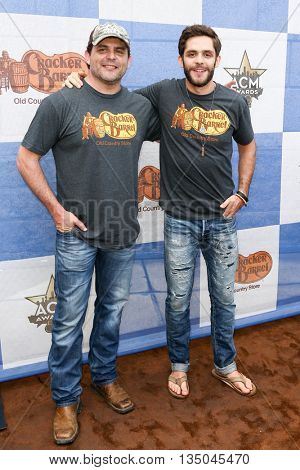 ARLINGTON, TX - APR 18: Rhett Akins (L) and son Thomas Rhett attend the Cracker Barrel Old Country Store Checkers Challenge at Globe Life Park in Arlington on April 18, 2015 in Arlington, Texas.