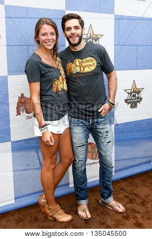 ARLINGTON, TX - APR 18: Singer Thomas Rhett (R) and wife Lauren Akins attend the Cracker Barrel Country Checkers Challenge at Globe Life Park in Arlington on April 18, 2015 in Arlington, Texas.