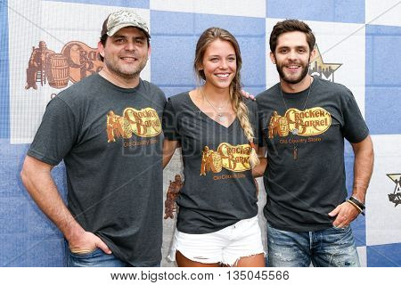 ARLINGTON, TX - APR 18: (L-R) Rhett Akins, Lauren Akins and Thomas Rhett attend the Cracker Barrel Country Checkers Challenge at Globe Life Park in Arlington on April 18, 2015 in Arlington, Texas.