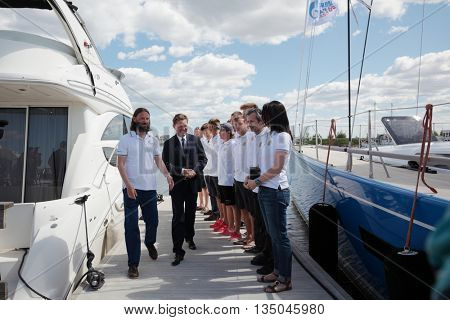 ST. PETERSBURG, RUSSIA - JUNE 4, 2016: Chairman of the Management Committee of Gazprom Alexey Miller  meet Russian team participating in the Nord Stream Race. Five teams compete in the race this year