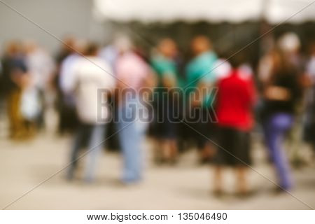 Blur people on outdoor social gathering abstract background