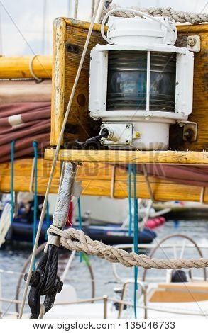 Yachting parts of old wooden sailboat in port of sailing rope sail lamp and lighting details of yacht