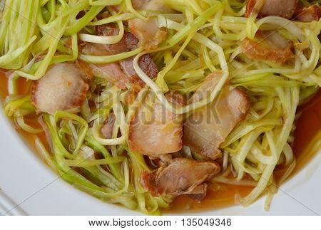 stir-fried white garlic chives with crispy pork on dish