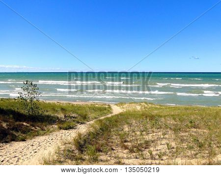 Trail leading to beach at Indiana Dunes Lakeshore. Chicago skyline can be seen on the horizon.