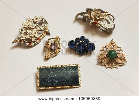 Various brooches with inserts from decorative stones