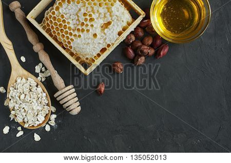 Honeycomb And Nuts, And Oatmeal And Wooden Dipper