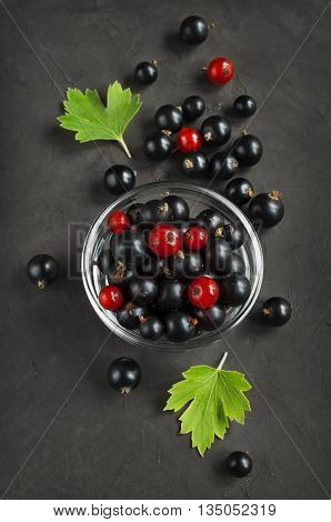 Black And Red Currants In A Glass Bowl