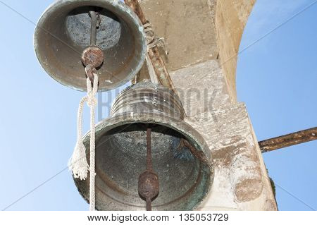 vintage bell on the ruined church on day