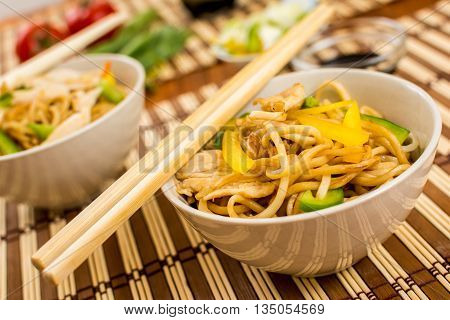 Traditional asian food chinese noodles with chicken meat and vegetables