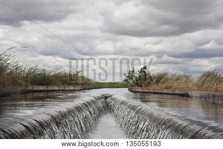 Floodgate area at huge irrigation canal of High Guadiana or Vegas Altas Extremadura Spain