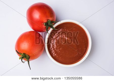 Tomato cream or puree in a ceramic bowl, Tomato sauce with fresh tomatos