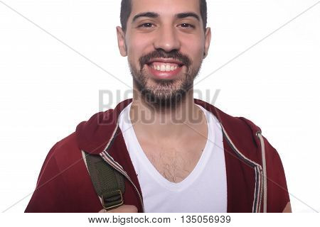 Close up of young latin man with backpack. Isolated white background.