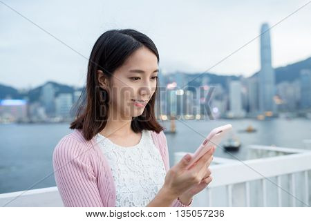 Young woman holding a mobile phone