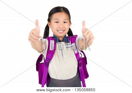 Cute asian primary student raised her thumb up