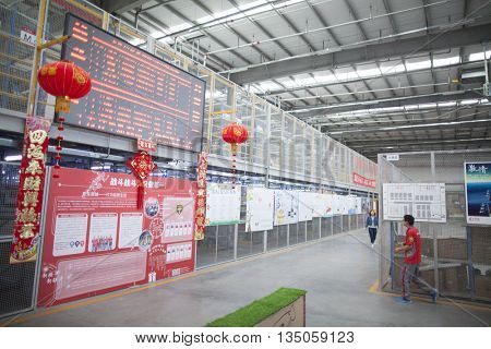 Gu'an, China - June 14, 2016: JD.com staff KPI board for receiving incoming goods, sorting products, and preparing shipments at the Northeast China based Gu'an warehouse and distribution facility