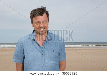 Charming And Attractive And Man On Beach