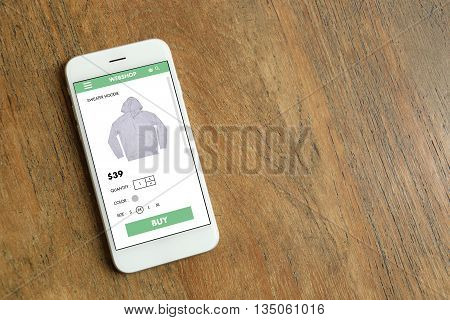 White color smartphone with ecommerce website screen