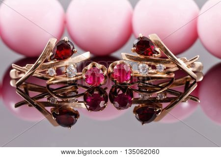 Two Sets Of Gold Earrings With Rubies And Alexandrites