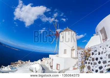 Oia Village With Windmill On Santorini Island In Greece