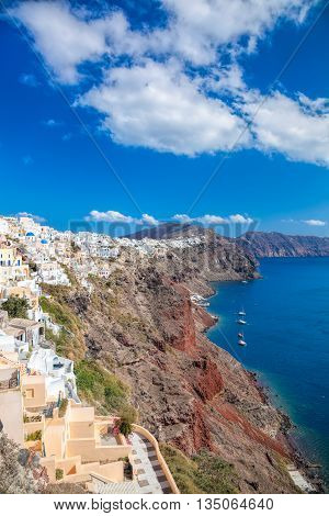 Oia Village With Sailboats On Santorini Island In Greece