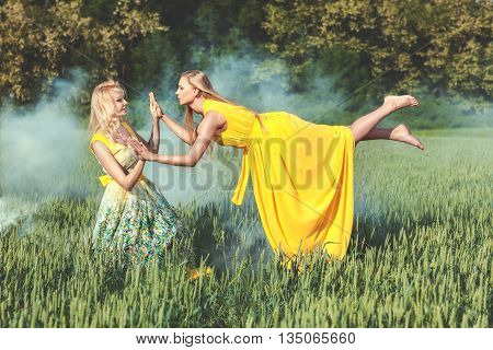 Two women one woman levitating they fabulous fairies.