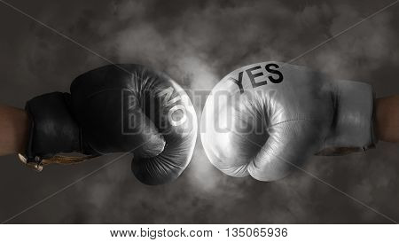 Two boxing gloves symbolize the struggle for a decision