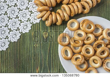 Wooden rustic table with national russian bagels. A group of bagels on a blue wooden table top view