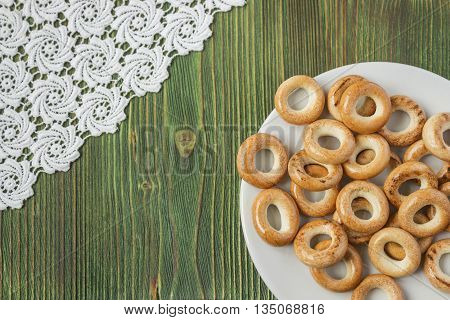 Wooden rustic table with national russian bagels. A group of bagels on a blue wooden table, top view