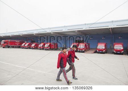 Gu'an, China - June 14, 2016: JD.com staff walking at shipping dock at the Northeast China based Gu'an warehouse and distribution facility, Gu'an, China