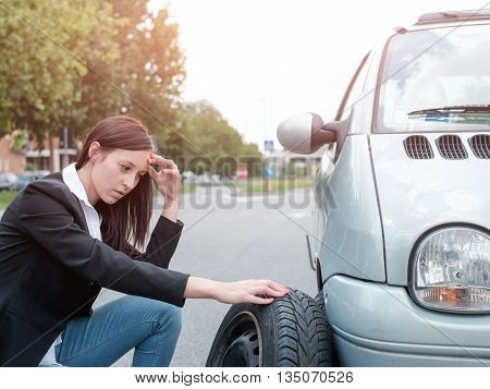 Sad woman after unexpected vehicle breakdown on the street