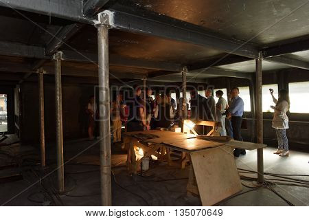 ST. PETERSBURG, RUSSIA - MAY 24, 2016: Journalists watch the construction of the passenger catamaran of the project 23290 at Sredne-Nevsky shipyard. The shipyard started producing such vessels in 2013