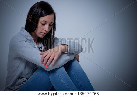Sad Depressed Woman Isolated On Gray Background