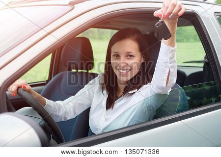 Happy young woman smiling after car purchase.