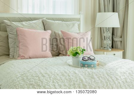 Cozy Bedroom Interior With Pink Pillows And White Tray Of Flower On Bed
