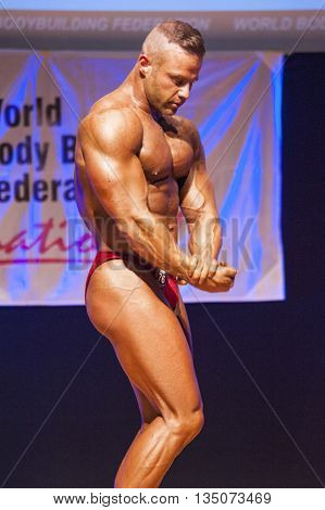 MAASTRICHT THE NETHERLANDS - OCTOBER 25 2015: Male bodybuilder flexes his muscles and shows his best side pose at the World Grandprix Bodybuilding and Fitness of the WBBF-WFF