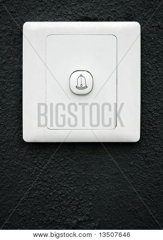 modern doorbell on black wall