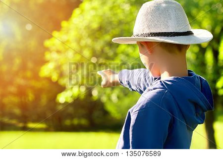 young tourist is showing the direction of his finger, summer
