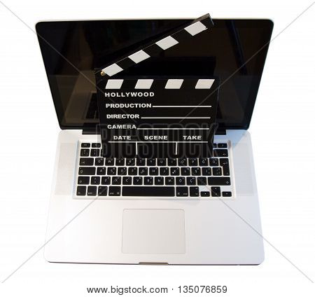 A photo of a laptop with a clapper board